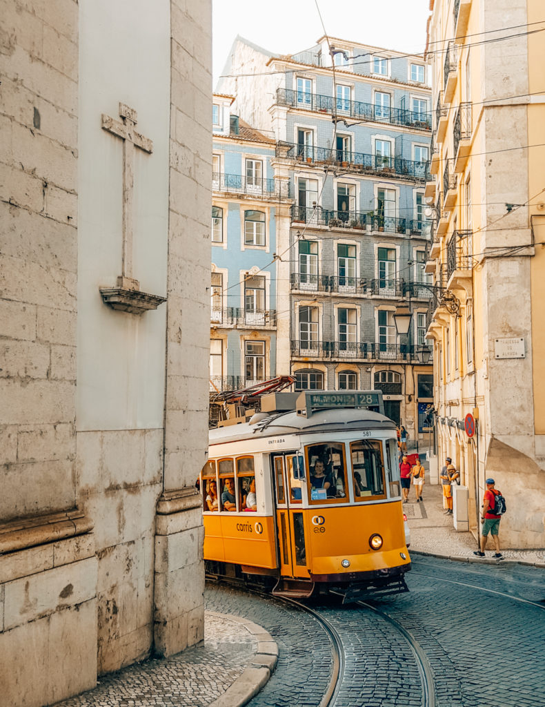 Tram 28 emerging from around the corner in Lisbon