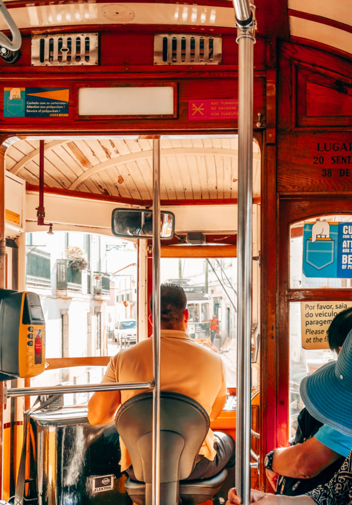 in Lisbon inside Tram 28, behind the driver